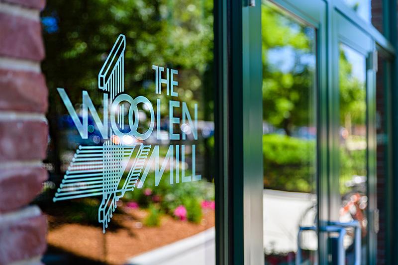 The Woolen Mill window sign